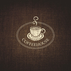 cup of coffee on a background fabric texture