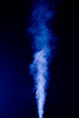 Blue vapor on the black background