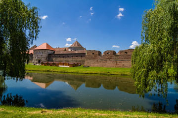 Medieval castle and it's water reflection, Fagaras, Romania
