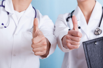 Close-up of a doctors showing thumbs up sign