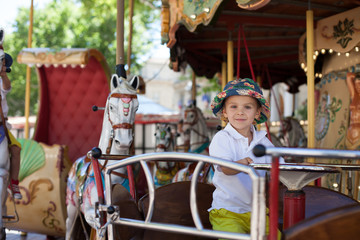 Cute kid, riding on a carousel