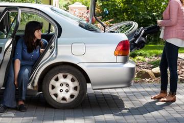 Girl taking wheelchair from car