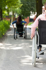 Disabled women on wheelchair outdoors