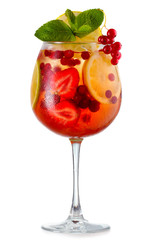 Alcohol cocktail with fresh mint, fruits and berries isolated