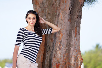 Woman leaning on a tree stock image