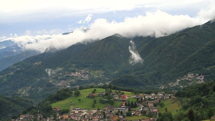 Clouds on a glimpse of Brembana valley, Alps - Italy