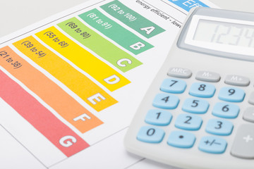 Energy efficiency chart with calculator - studio shot