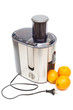 a juicer and oranges