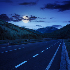 asphalt road in mountains at night