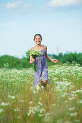 Girl with wild spring flowers