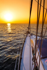 sea yacht deck on tropical sunset sea background