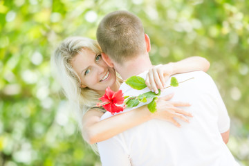 young loving couple on natural background
