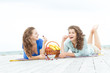 two young happy women enjoying life during outdoor picnic with f