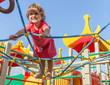 cute happy child girl on playground