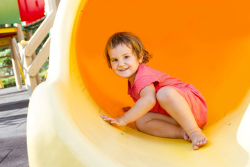 cute happy child girl on playground