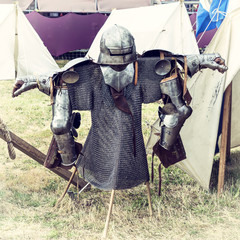Armor in a medieval camp. Vintage effect.