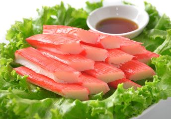 decorate crab stick in white plate
