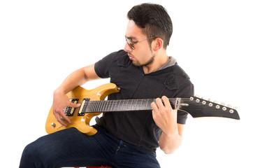 hispanic young man playing electric guitar