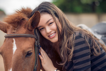 Asian girl and pony