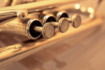 Detail of trumpet closeup in golden tones
