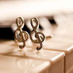 Ornaments in the form of a treble clef on piano keyboard