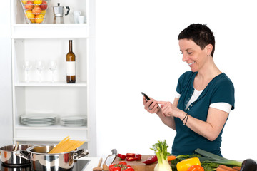 woman in the kitchen using smartphone