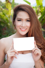 Beautiful asian women holding blank card