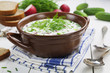Cold summer soup with yogurt and vegetables
