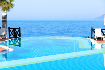 Infinity swimming pool with beautiful view in luxury hotel
