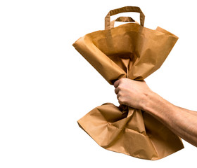 Paper bag in male hand isolated from white background