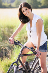 Portrait of an happy woman with bicycle
