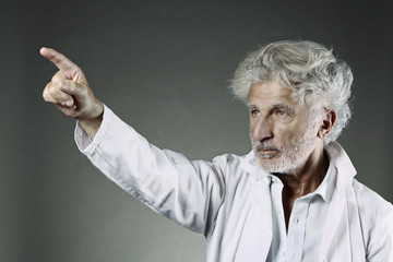 White hair scientist shows with finger