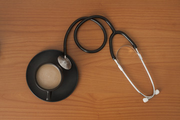 Stethoscope with coffe cup