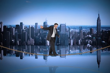 Composite image of mature businessman doing a balancing act on t