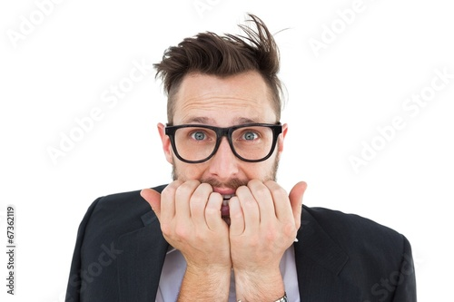 Geeky nervous businessman looking at camera