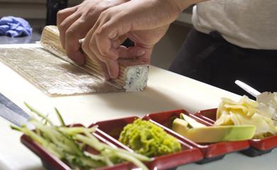 Making sushi roll