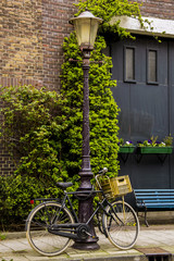 Bicycle tied on a light pole in Amsterdam