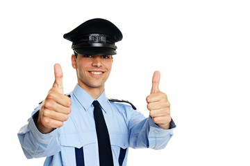 Smiling young policeman shows you thumbs up
