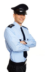 Portrait of young smiling policeman standing