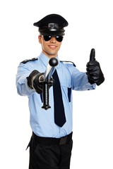 Young smiling policeman in sunglasses shows you thumbs up