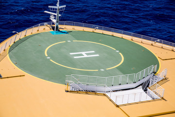 Green Helicopter Pad on Deck of Ship