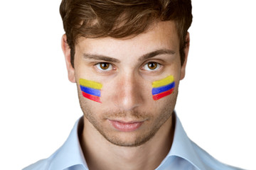 soccer fan with colombia flag painted at the face