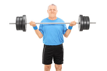 Strong elderly man holding a heavy weight