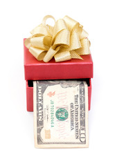 Red gift box with dollar bills on white background
