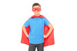 Boy in a superhero costume posing