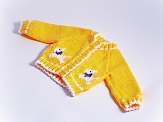 Baby's hand knitted gardigan © Arena Photo UK