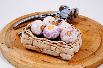 Garlic bulbs and press © Arena Photo UK