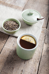 Tea set with tea crop and mug. Selective focus.