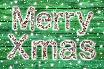 Merry christmas letters on wooden green background