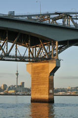Concrete pillar of Auckland Harbour bridge on winter day